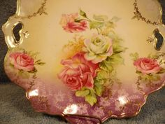 ROSE FLORAL pierced handled plate. Red Mark R.S. by JANDRSANTIQUES
