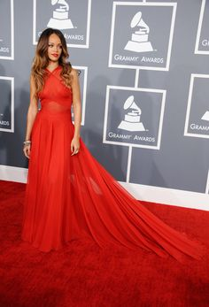 Rihanna In Azzedine Alaia  The pop star surprised us by wearing something so romantic (no comment, however, on her romantic choices). Her crimson gown showed off her toned upper body and complemented her ombré hair while the dreamy train was pure glamour.