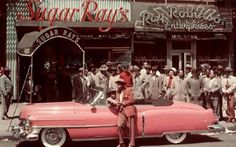Elvis made pink Cadillacs famous, but it turns out his inspiration came from someone else: boxing great Sugar Ray Robinson, who was known for his collection of automobiles — most notably his 1950 flamingo-pink Cadillac