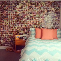 The colours of the pillows and bed spread are my absolute favorite combo!!! Great Idea with the picture wall, too.