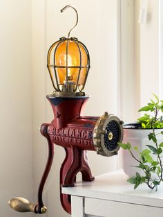 """Rusty Remakes Signature """"Red Baron"""". Made from a vintage red Husqvarna meat grinder and a vintage lamp cage."""
