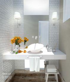 Lavabo | Banheiro para visitas em cores claras e neutras, com tijolinho aparente branco. Luminárias nas laterais do espelho. Uso de piso em porcelanato com aparência de madeira.
