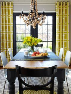 Mix it up! Bold yellow geometric curtains and a funky DIY wood bead chandelier...a farmhouse table, modern chairs and black french doors .... a creative mix of traditional/trendy/country/city!