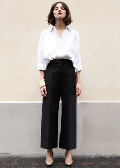 "High Waisted, Flat Front Pants w/Wide, Cropped Leg 2 Side Pockets. Zip, Hook & Eye Closure. Not Lined 56% Cotton, 36% Nylon, 8% PU 24"" Inseam Length, 13"" Rise, Waist- S/26"", M/28"" Dry Clean Imported"
