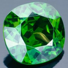 Closeup of a 'horsetail' inclusion in Demantoid Garnet.  The Handbook of Gemmology photographed by Tino Hammid.