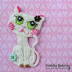 Meow ..:-) Little girls like little cats so much. You could make the clothes of your little girl very special and cute using this sweet applique of crocheted cat.