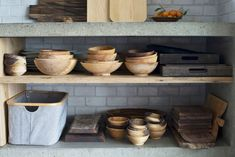 Stacks of bowls made by artist Jess Hirsh are stored on lower shelves.