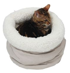 Kitty beds simply do not get any more snuggly than this! Just taking minutes now to fully appreciate our little cat model 'Tibbles' snuggling up inside the Rustle Bed?  Now, just imagine how your feline friend will feel when they also share in this luxurious and cosy experience themselves...  The Rustle Bed is made from soft, plush, velour fabric that your little kitty will simply melt into! Catnaps will never be the same again!  With its stylish and neutral design, the Rustle Bed were…