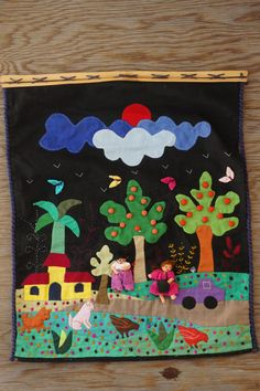 Very colorful Colombian applique wall hanging. Handmade by women in Colombia. Measures : 18 by 15. Wood frame on bottom has a crack other than
