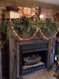 Rustic Christmas...mantel with old crocks, pine, & prim garland.