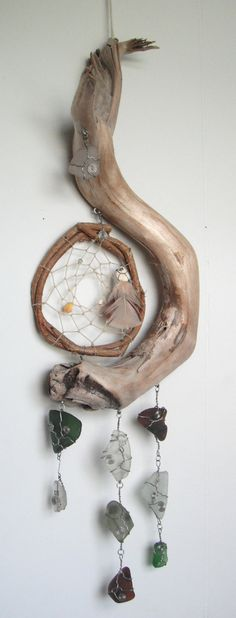Beautiful and Unique Hand Made Dream / sun catcher. This one of a kind piece is made with Vermont Mountain river driftwood, grapevine and Maine beach sea glass, sea pottery and shells. Driftwood Projects, Driftwood Art, Driftwood Seahorse, Driftwood Signs, Driftwood Ideas, Driftwood Beach, Los Dreamcatchers, Diy Rustic Decor, Rustic Signs