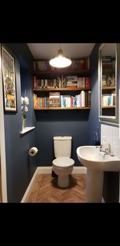 Downstairs toilet, shelves made from scaffold boards with industrial brackets. Colour is Farrow & Ball Stiffkey Blue Downstairs toilet, shelves made from scaffold boards with industrial brackets. Colour is Farrow & Ball Stiffkey Blue Small Toilet Decor, Small Toilet Room, Small Bathroom, Bathroom Ideas, Cloakroom Ideas, Toilet Decoration, Dark Bathrooms, Bathroom Showers, Attic Bathroom