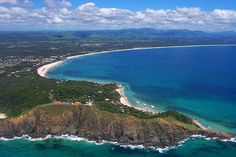 Aerial view of Cape Byron, the easternmost point of Australian mainland. The Cape is home to Cape Byron State Conservation Area and is part of the 22,000 hectare Cape Byron Marine Park, which was founded in 2002.
