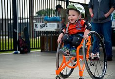 18 month old boy with spins bifida exited to learn how to skateboard at adaptive sports event in Irvine, CA