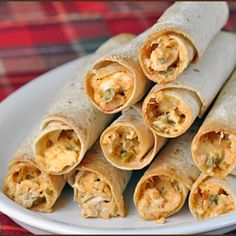 Chicken, corn, beans,and cheese are rolled up in corn tortillas, then covered with homemade enchilada sauce for a delicious and comforting meal!