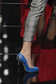 News Photo: Shoe detail on the runway at the John…