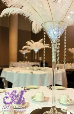White ostrich feather centerpiece with martini vase & hanging crystals                                                                                                                                                                                 More