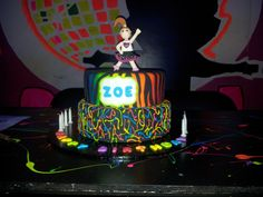 The mum who made this fantastic cake even dressed the home made figurine in the birthday girls' party clothes! Wow!