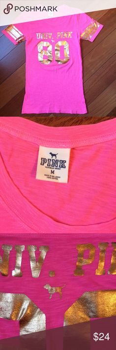NWOT VS Pink Football T Sz M Fitted M. 15.5 inch across chest. Gold decal, slight burn out style see pics. Never tried on worn or washed. PINK Victoria's Secret Tops Tees - Short Sleeve