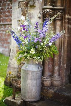 Purple Wedding Flowers Love in a Wiltshire country garden - Summer weddings - YouAndYourWedding - In the beginning . - Clare and Rich filled a countryside venue with rustic charm and loads of personal touches Deco Floral, Arte Floral, Country Wedding Flowers, Wild Flower Wedding, Summer Wedding Flowers, Country Weddings, Deco Champetre, Church Flowers, Delphiniums