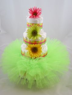 Sweet centerpiece for a spring baby shower. Neon green Tutu Diaper Cake.