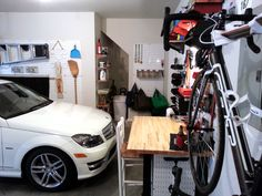 Wall Control white metal pegboard tool board panels really make a statement on a bland garage wall. Make your garage more functional and much nicer looking by adding some clean, modern Wall Control metal pegboard panels.