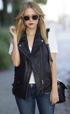 leather vest and white shirt
