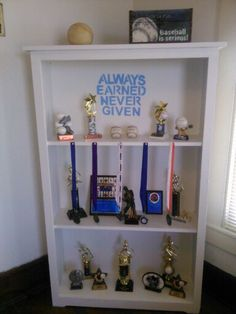 Painted an old shelf which is now my sons baseball trophy self ! Always earned never given! Trophy Shelf, Trophy Display, Traditional Desk Accessories, Kids Decor, Diy Home Decor, Boy Room, Kids Room, Trophy Cabinets, Glass Cabinet Doors