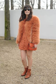 Alessandra wears  a Valentino Fur, dress and bag from the Pre Fall 14/15 collection and  Valentino Sunglasses from the from the Fall Winter 13/14 collection to the Fall Winter 14/15 Fashion Show, March 4th, 2014, Paris.