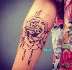 Rose tattoo on inside of the elbow