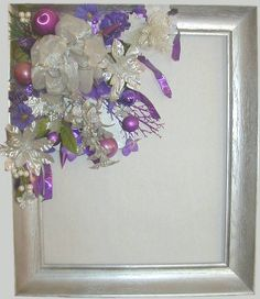 Modern style wreath made from up-cycled picture frame painted silver with purple and silver decorations.