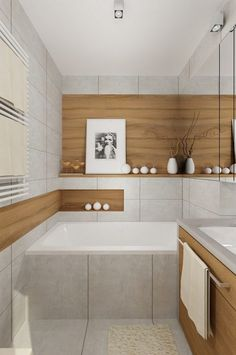 Große Fliesen kleines-bad-hellgrau-holzoptik-badewanne