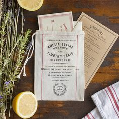 Market | Lucky Luxe Couture Correspondence | Letterpress Wedding Stationery. From the rolling hills of California to the lavender fields of Provence, Market is the quintessential wedding invitation for an elegant rustic wedding in the countryside. Inspired by French grain sacks and fresh picked farmer's market herbs, enclosure cards tuck perfectly inside our 100% cotton miniature grain sack invitations which are handprinted and available with or without vintage red stripes.