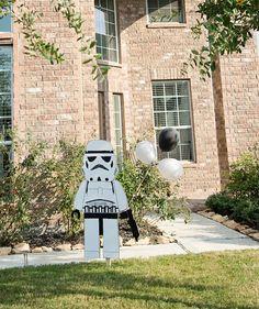 Stormtropper holding balloons entrance idea