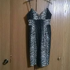 Leopard print dress Leopard print dress is a large in cream & black. I never wore it. The dress is not lined. It is in excellent condition. Dresses