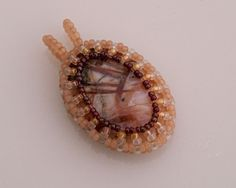 Bamboo agate pendant P182 Bamboo agate and seed beads, silver plated chain. The pendant is 45x25mm including the bail, any chain length (please specify at check-out) $26