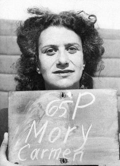 """February 3, 1947: After a trial lasting two months, all fifteen former members of the staff at Ravensbruck concentration camp, where 100,000 women were said to have died during WWII, were found guilty by the Hamburg war crimes court. 12 were sentenced to death.    Pictured here is Carmen Mory, a """"kapo"""" - a prisoner at the camp who was assigned by the SS to supervise forced labor. She was sentenced to death but committed suicide on April 9, 1947    Photo: Planet News Archive/SSPL/Getty"""