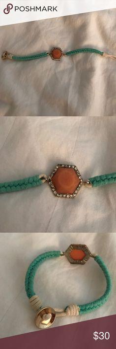 Anthropologie Braided Bracelet w Coral Rhinestone Anthro Braided rope bracelet with coral and Rhinestone center. Good condition. Anthropologie Jewelry Bracelets