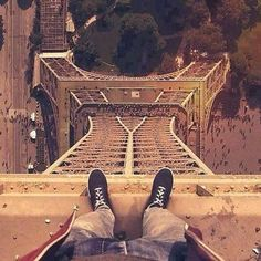 Standing on top of Eiffel Tower.