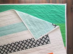 Hey, I found this really awesome Etsy listing at https://www.etsy.com/listing/221183563/the-overunder-quilt-modern-stripe-quilt