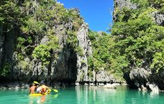 Off Palawan in the Philippines, Miniloc island has a coastline pocketed with beaches, caves, and lagoons. Through a narrow opening in the limestone walls, you can kayak into its Small Lagoon where jellyfish pulse through deep teal waters.