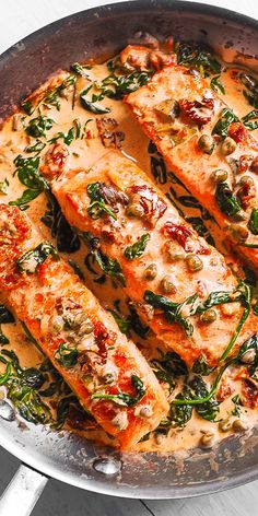 Pan-Seared Creamy Tuscan Salmon with Garlic, Spinach, Artichokes, Sun-Dried Tomatoes, and Capers. This recipe features the best white cream sauce for salmon! Ready in 30 minutes! If you're looking for a family-friendly dinner recipe to Fish Dinner, Seafood Dinner, Seafood Salad, Seafood Recipes, Cooking Recipes, Healthy Recipes, Baked Salmon Recipes, Salmon Spinach Recipes, Best Cod Recipes