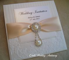 Pearl drop luxury wedding invitation! www.quillsweddingstationery.co.uk www.facebook.com/pages/Quills-Wedding-Stationery/278003989009997