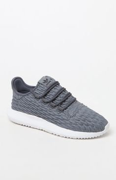 """Stand out from the crowd with help from the adidas Women's Tubular Shadow Sneakers. These modern, '90s-inspired kicks boast a textured leather upper, a comfortable textile lining, an EVA midsole for lightweight cushioning, and a """"burrito"""" tongue that has a contoured design for a snug fit.    Textured leather upper  adidas logos on tongue and heel  Low profile shoe, lace front  Contoured """"burrito"""" tongue  Comfortable textile lining  EVA midsole with rubber pads  Rub..."""