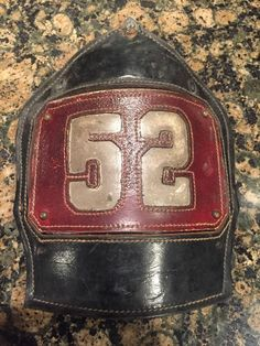 FDNY Ladder 52 Cairns And Brother Leather Fire Helmet Front FDNY Helmet