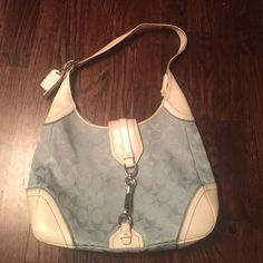 Coach Latch shoulder Bag Authentic coach bag in light blue with white leather. Light staining (never been cleaned) on exterior and staining in back interior pocket, leather in very good shape. Snap pocket on back of purse and zip pocket on interior. Coach Bags Shoulder Bags