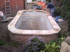 Lovely bricked garden pond.