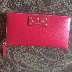 KATE SPADE RED WALLET Kate spade red wallet. Used very little. The color is to die for. Hold 16 cards and has large coin pocket in the middle. No signs of wear. No stains or rips. Hardware is gold. PRICE IS FIRM!! kate spade Bags Wallets