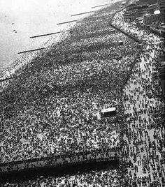 NYC. Coney Island during a 1950s heatwave  I remember Jones Beach and Orchard Beach being like this as well.