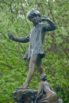 Peter Pan statue at Kensington Gardens, London England...This is my favorite part of Kensington Gardens <3